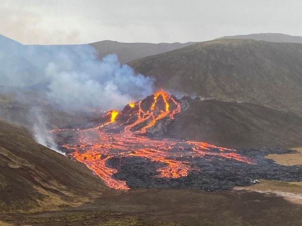 Lava flows Saturday from the Fagradalsfjall volcano on Iceland's Reykjanes Peninsula. The long-dormant volcano erupted Friday evening.