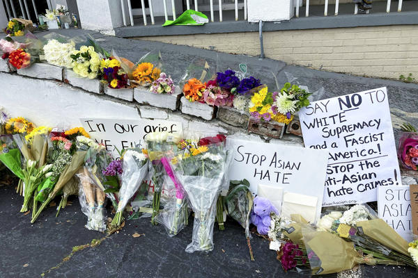 A makeshift memorial is seen on Friday in Atlanta, following the mass shooting of eight people, six of whom were of Asian descent, at three different massage parlors.
