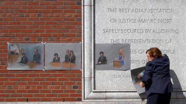 The U.S. Supreme Court will review a lower court's decision from last summer that vacated the six death sentences imposed on Boston Marathon bomber Dzhokhar Tsarnaev. Here, artist Jane Flavell Collins pulls down her courtroom sketches outside the Moakley U.S. Courthouse in Boston after Tsarnaev was sentenced.