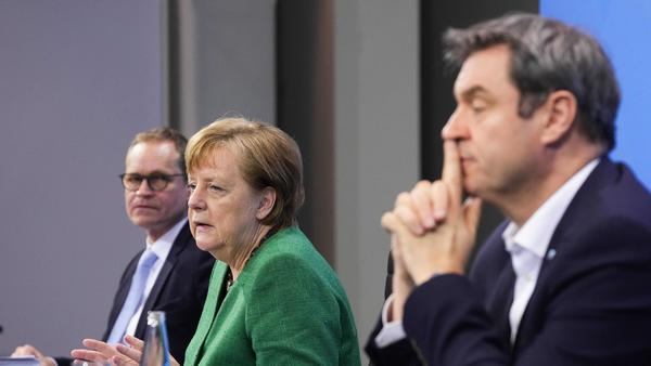 German Chancellor Angela Merkel, with Bavaria's State Premier Markus Soeder (right) and Berlin's Mayor Michael Mueller, participate in a news conference following talks via videoconference with Germany's state premiers on the extension of the current COVID-19 lockdown in Germany.