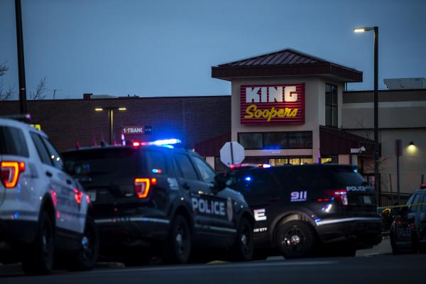 Police respond to an attack on a King Soopers grocery store in Boulder, Colo., where a gunman opened fire Monday. Ten people, including a police officer, were killed.