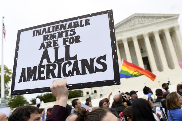 In this Oct. 8, 2019, file photo, protesters gather outside the Supreme Court in Washington where the Supreme Court is hearing arguments in the first case of LGBT rights since the retirement of Supreme Court Justice Anthony Kennedy.
