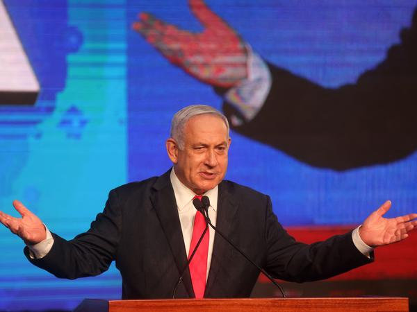 Israeli Prime Minister Benjamin Netanyahu, leader of the Likud party, addresses supporters at the party campaign headquarters in Jerusalem early Wednesday after the end of voting in the fourth national election in two years.