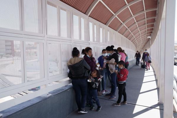 A group of migrants rapidly deported from the U.S. under Title 42 wait on the Mexican side of the Paso del Norte International Bridge, between El Paso, Texas and Ciudad Juarez, Mexico on March 10.