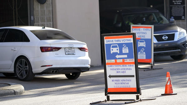 Cars enter and leave a drive-thru voting site in Houston on Election Day in 2020. Texas Republican lawmakers are looking to ban the practice.