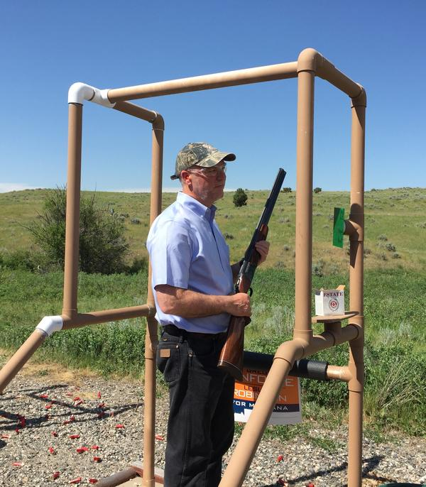 In this undated photo from 2016, Greg Gianforte holds a shotgun.