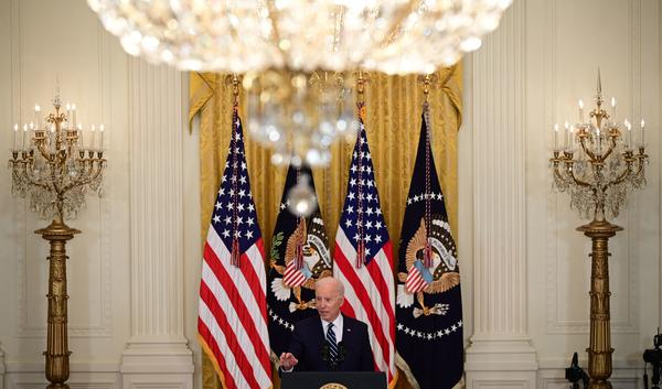 President Biden speaks during his first press briefing in the East Room of the White House on Thursday.