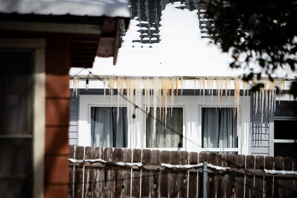 Icicles hang from a roof in the Travis Heights neighborhood of South Austin on Monday.