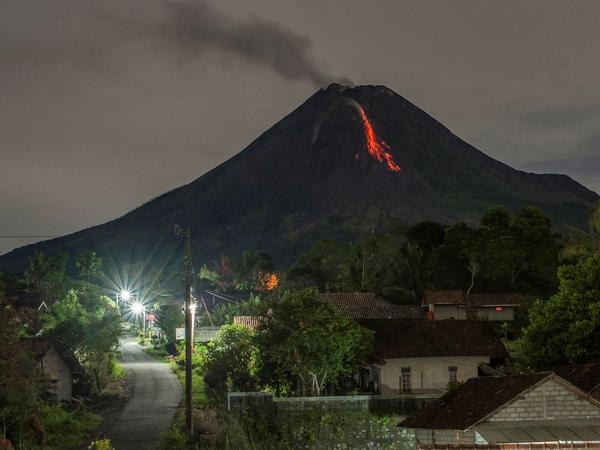 Lava flows down from the crater of Mount Merapi, Indonesia's most active volcano, as seen from Tunggul Arum in the city of Turi near Yogyakarta early Saturday.