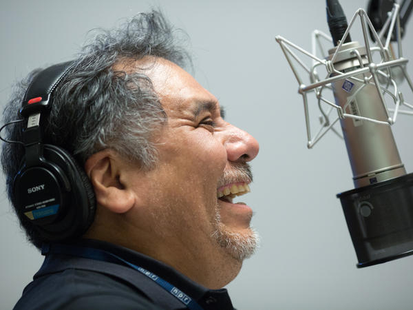 Felix Contreras, host of NPR's Alt. Latino, records a segment in a studio at NPR headquarters in Washington, D.C., on September 12, 2018. (photo by Allison Shelley for NPR)