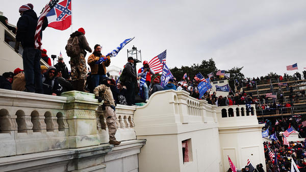 """Thousands of supporters of former President Donald Trump storm the U.S. Capitol following a """"Stop the Steal"""" rally on Jan. 6. Prosecutors are working on hundreds of charges related to the breach."""