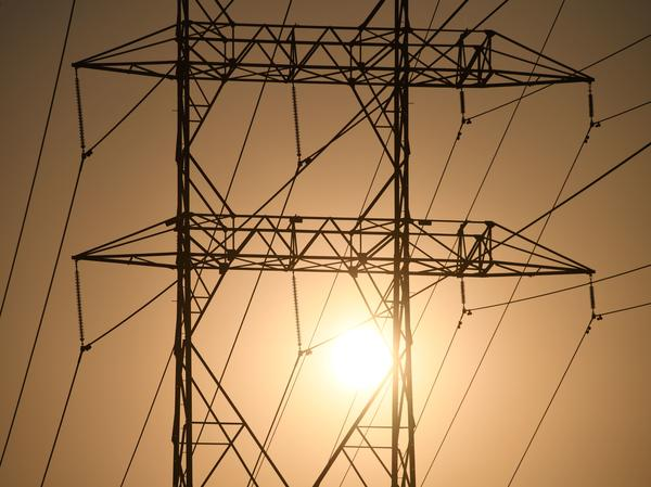 Electrical power line towers are seen in Los Angeles in August. Overdue power bills have mushroomed during the pandemic as job losses mounted and power consumption soared.