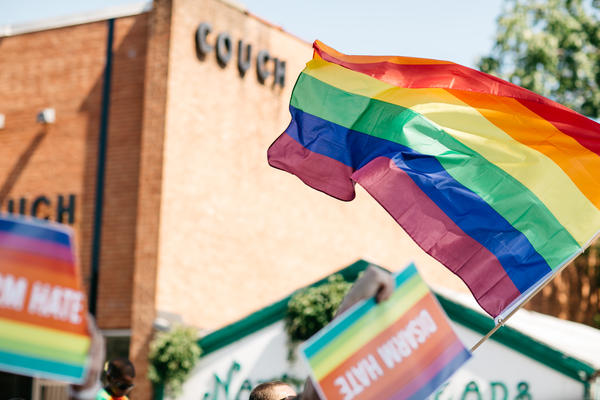 A Pride Flag is waved during the 2016 NC Pride parade in Durham.