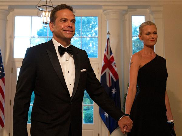 Fox Corp.'s Lachlan Murdoch and his wife, Sarah, arrive at the White House for a 2019 state dinner honoring Australian Prime Minister Scott Morrison. Murdoch and his family have left the U.S. for Sydney through at least the end of summer.