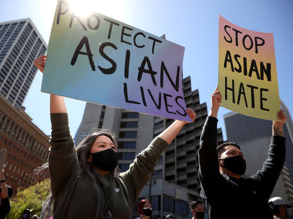 Protesters hold signs during a rally to show solidarity with Asian Americans at Embarcadero Plaza in San Francisco on March 26. The White House has unveiled new measures to address violence and harassment against the AAPI community.