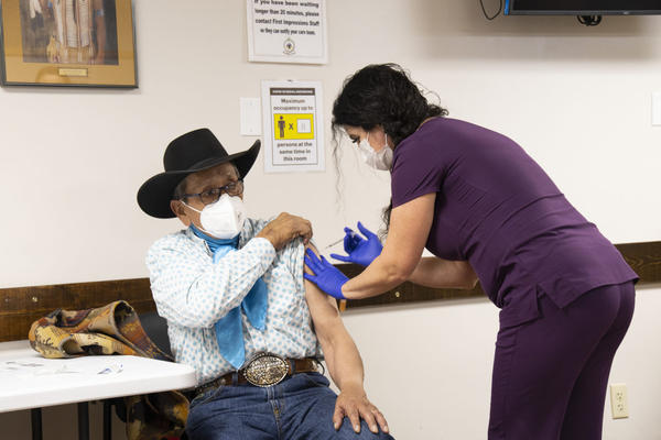 Northern Arapaho ceremonial elder George Moss was the first to be vaccinated against the coronavirus on the Wind River Reservation