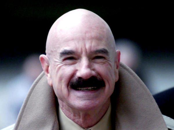 G. Gordon Liddy, pictured in 2001, died on Tuesday at the age of 90. He was convicted of orchestrating the Watergate burglary and wiretapping scheme that led to President Richard Nixon's disgraced resignation.