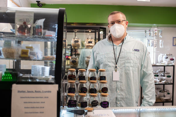 Pepper Petersen, president of the Montana Cannabis Guild, poses in a Helena medical dispensary on March 17, 2021.