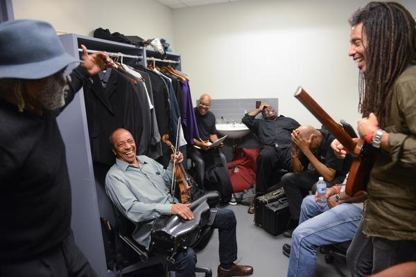 Frank Lacy (left) entertains a group of Very Very Threadgill performers backstage at Harlem Stage.