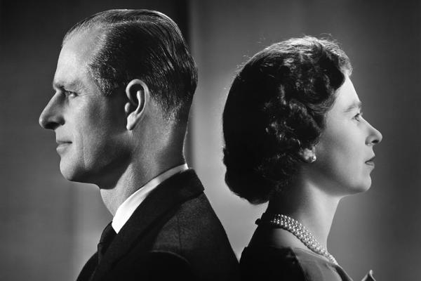Queen Elizabeth II and Prince Philip, Duke of Edinburgh, pose for a portrait at home in Buckingham Palace in 1958.