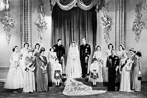 Members of the British royal family and guests pose around Princess Elizabeth and Philip, Duke of Edinburgh, in the Throne Room at Buckingham Palace on their wedding day, Nov. 20, 1947.