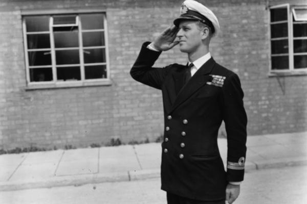Lt. Philip Mountbatten salutes as he resumes his attendance at the Royal Naval Officers School at Kingsmoor, Hawthorn, England, in summer 1947.