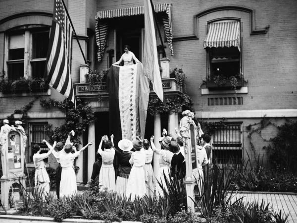 Alice Paul, a leader of the National Woman's Party, unfurls the ratification banner with its new 36th star after Tennessee ratified the 19th Amendment on Aug. 18, 1920. The amendment prohibits denying the right to vote based on sex.
