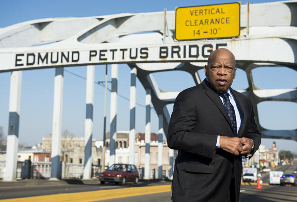 """In 2015, the late Rep. John Lewis stands on the Edmund Pettus Bridge in Selma, Ala., where he was beaten by police on """"Bloody Sunday."""""""