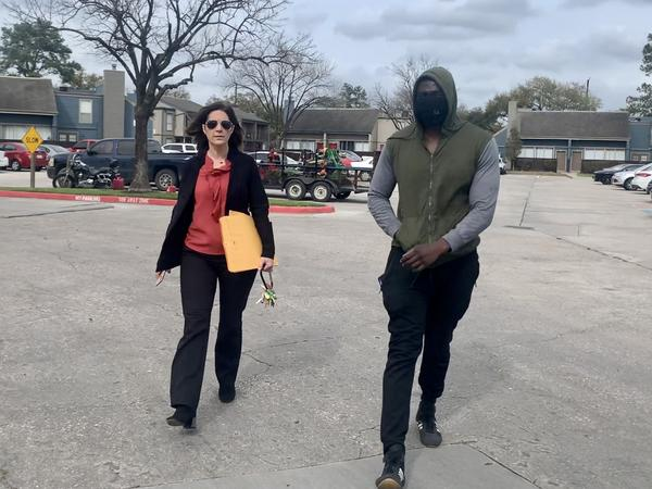 Landlord Stephanie Graves walks to the main office at one of her properties in Houston with a resident. She's going door to door offering to help residents apply for rental assistance money approved by Congress that's just starting to flow to landlords and tenants.