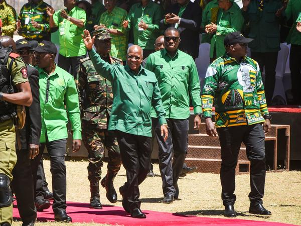 Tanzanian President John Magufuli (center) arrives to give a speech at a stadium in Dodoma, Tanzania, in August. Magufuli's death was announced Wednesday. He was 61.