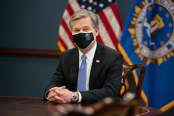 """FBI Director Christopher Wray tells NPR that the bureau will keep working on its sprawling investigation into the Jan. 6 attack on the U.S. Capitol """"no matter how long it takes."""""""