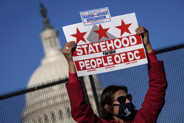 Residents of the District of Columbia rally for statehood Monday near the U.S. Capitol ahead of a House committee hearing on the effort.