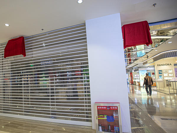 H&M logos are covered by red cloth at a closed store Thursday in Urumqi in China's Xinjiang Uyghur Autonomous Region.