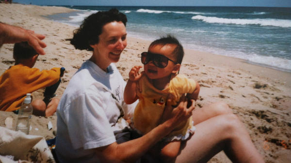Emma LeMay, now 22, with her mother at the Jersey shore. LeMay, adopted from Chongqing China, was raised in Vermont and now lives in Atlanta.