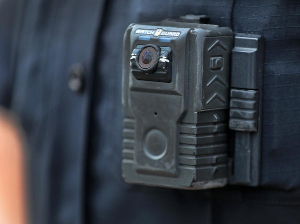 Police officer David Moore is pictured wearing a body camera in Ipswich, Mass., on Dec. 1, 2020. The city was among 25 statewide awarded grants to purchase body-worn cameras for videotaping interactions with the public. A new study says the benefits to society and police departments outweigh the costs of the cameras.