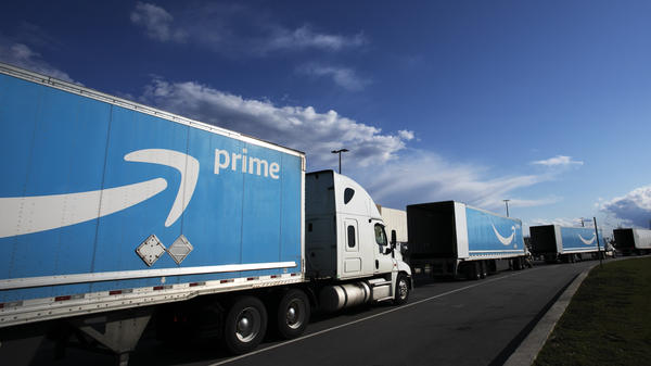 Amazon tractor-trailers line up outside an Amazon Fulfillment Center on Staten Island in New York City in April 2020. The pandemic has been good for the company's bottom line.
