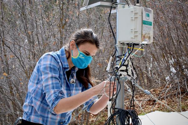 Elise Osenga maintains one of Aspen Global Change Institute's 10 soil moisture monitors. Researchers use data from stations like this one to figure out how much snowmelt and precipitation will reach rivers and streams.