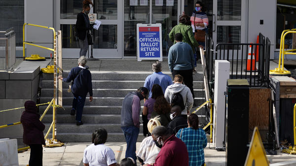 Residents line up outside the Montgomery County voter services office in October in Norristown, Pa. Last year, Joe Biden ran up the vote margins in the collar counties of Philadelphia, including Montgomery.