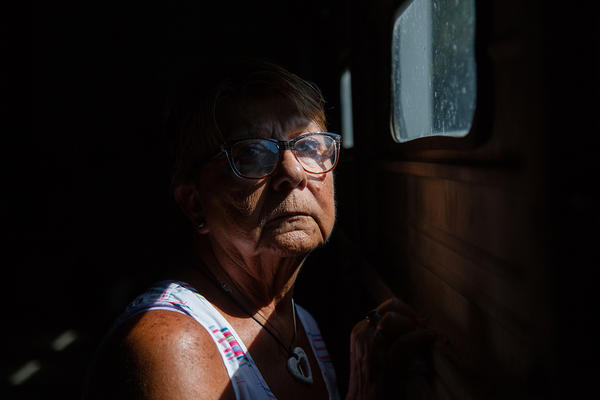 Linda Findley' stands in her husband Robert Findley's auto body shop in Ft. Scott, KS. Robert Findley fell on the ice during a winter storm and delayed care because of the distance to a hospital led to Robert's death.