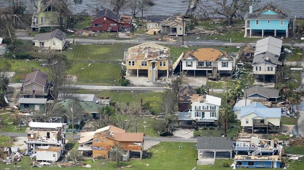 Damaged buildings and homes are damaged in the aftermath of Hurricane Laura near Lake Charles, La., Thursday.