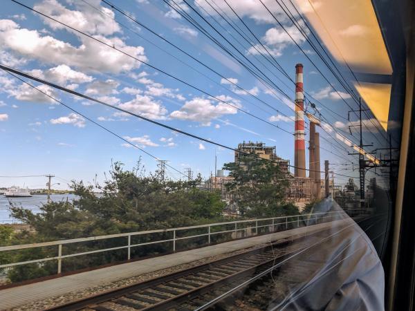 Amtrak's Northeast Regional line rolls through Connecticut past a gas power plant.