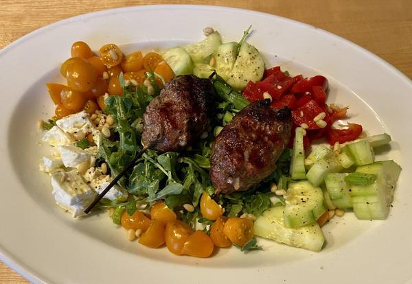 Lamb köfte with Greek-style spring salad. (Kathy Gunst)
