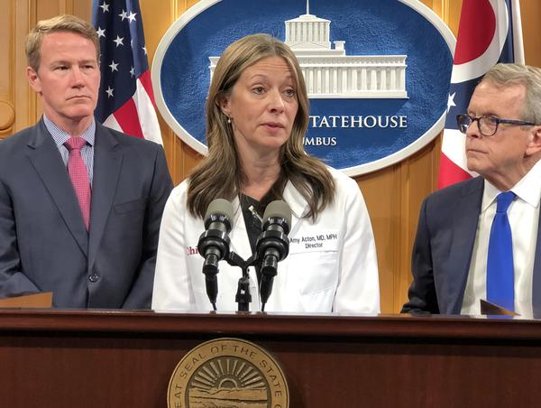 Dr. Amy Acton, Ohio Department of Health director with Lt. Gov. Jon Husted (R-Ohio) and Gov. Mike DeWine (R-Ohio)
