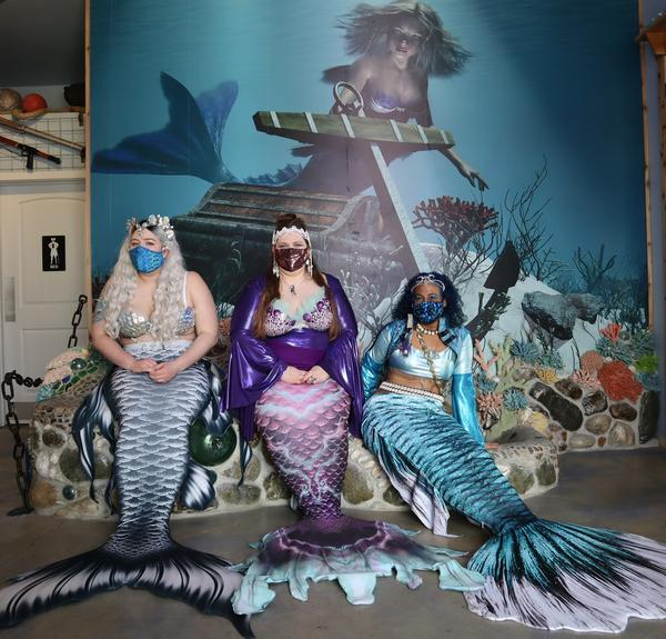 From left, Mermaid Siren Ophelia of Seattle, Mermaid Asherah and Mermaid Merina both of Portland, at the opening of the new International Mermaid Museum near Aberdeen, Washington.