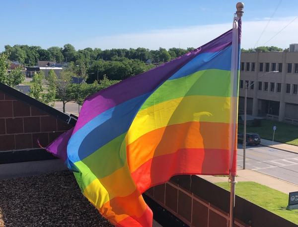 Independence Mayor Eileen Weir hangs a rainbow flag outside of her office during Pride Month since proposals to hang pride flags on city buildings has gone unapproved.