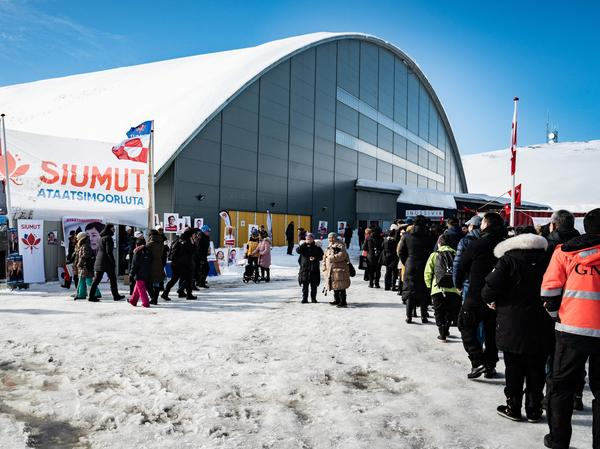 Voters stand in line to cast ballots Tuesday for Greenland's parliamentary elections at a polling station in the capital.