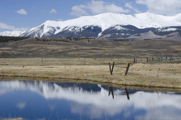 Mountains overlook ranch land near Leadville, Colorado.