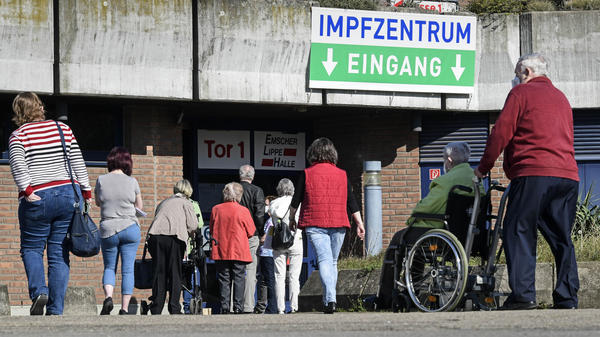 People wait in front of the vaccination center in Gelsenkirchen, Germany, Wednesday, last week. Germany's health minister says the country is exploring purchasing the Sputnik V COVID-19 vaccine from Russia.