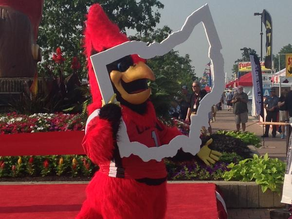 Cardinal holds Buckeye sign at Ohio State Fair