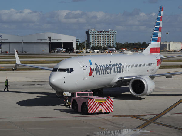 Boeing said Friday that some of its 737 Max planes may have an electrical problem, leading airlines to ground dozens of the jets. An American Airlines flight on a Boeing 737 Max is seen here in December in Miami.